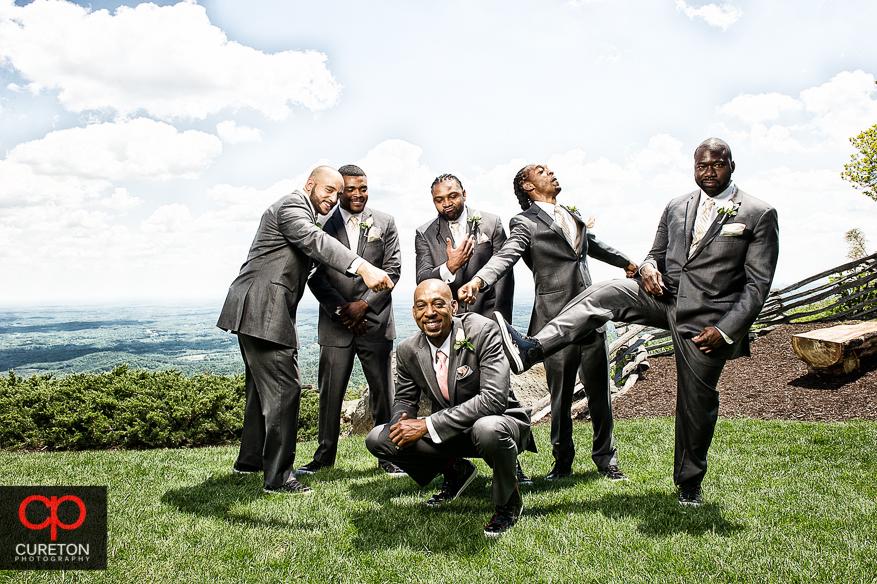 The groomsmen kidding around.
