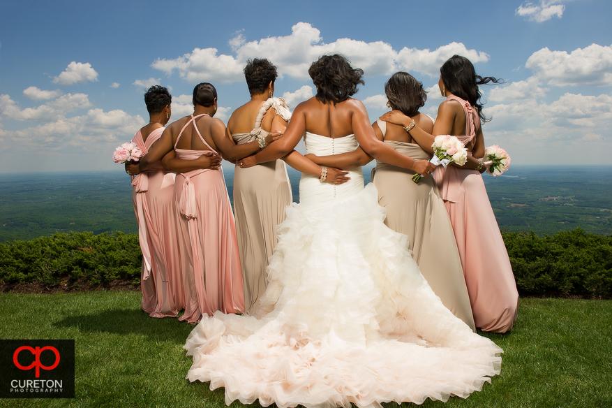 Beautiful back shot of the bridesmaids at Glassy Chapel.