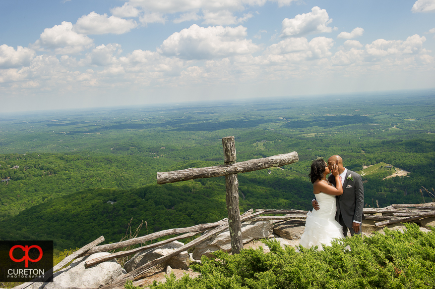 Bride and groom overlooking the mountains at Glassy Chapel.