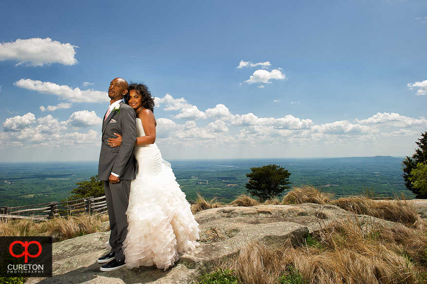 Groom and Bride in the clouds at Glassy Chapel..