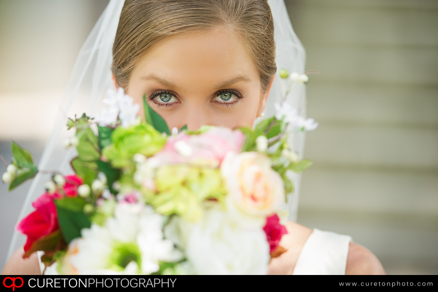 Bride holding flowers at The Robert Mills House in Columbia,SC.