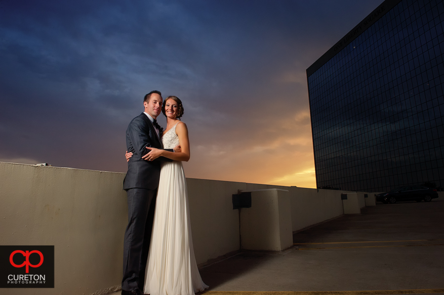 Newly married couple at sunset in downtown Greenville.