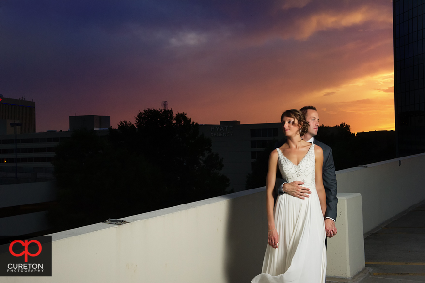 Bride and Groom at sunset overlooking the downtown Greenville skyline.