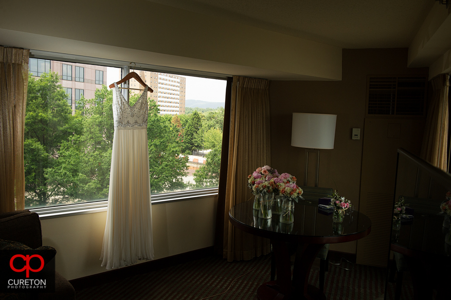 Bride's dress hanging in the window at the downtown Hyatt.
