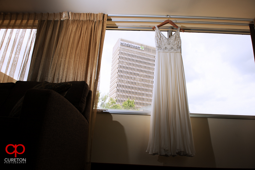 Bride's dress hanging in the hotel window.