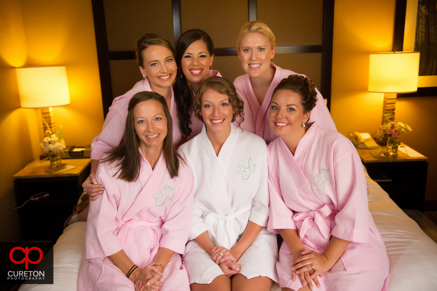 Bride and her bridesmaids in matching robes.