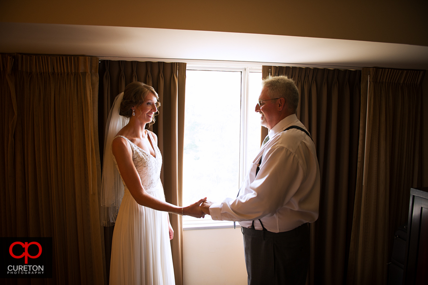 Bride's father seeing her for the first time in the dress.
