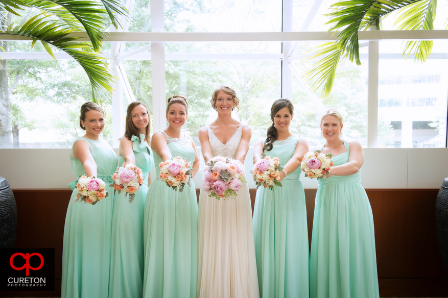 Bridesmaids in the lobby of the Hyatt Regency Greenville before her wedding,