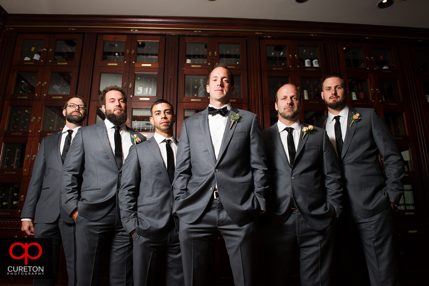 Groom and groommen before the wedding in the wine room at the Commerce Club in Greenville,SC.