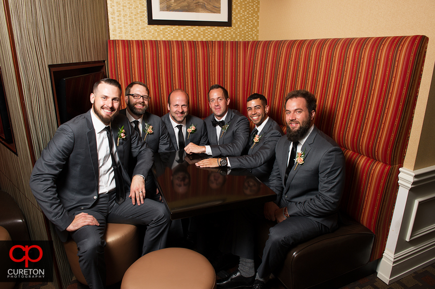 Groomsmen hanging out the Commerce Club bar.