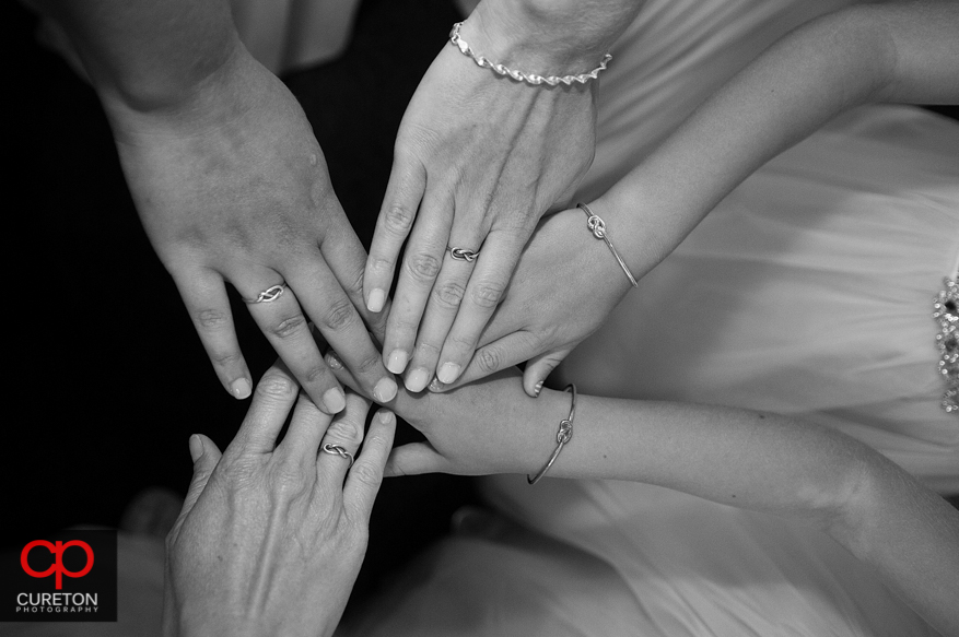 The bridesmaids all show off matching rings.