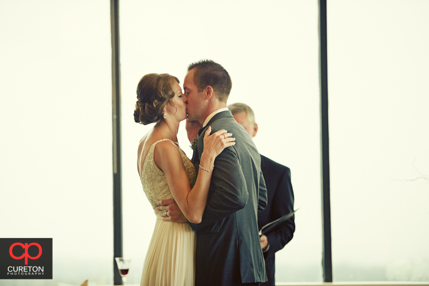 Bride and Groom fist kiss.