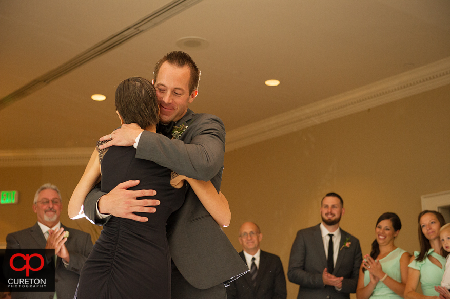 Groom hugs his mother.