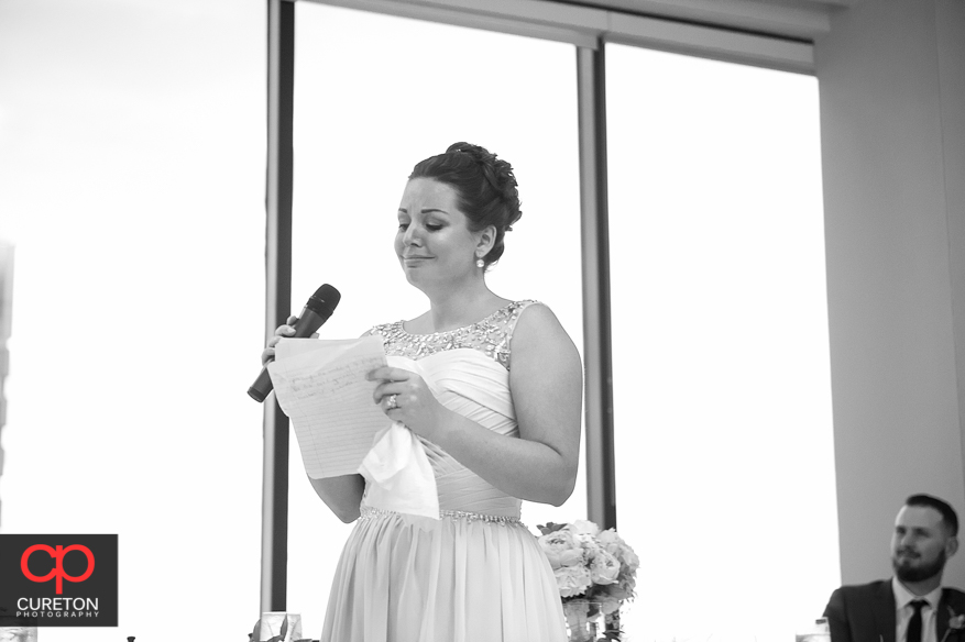 Bride's sister gives a toast.