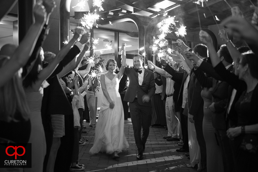 Bride and groom leave through sparklers.
