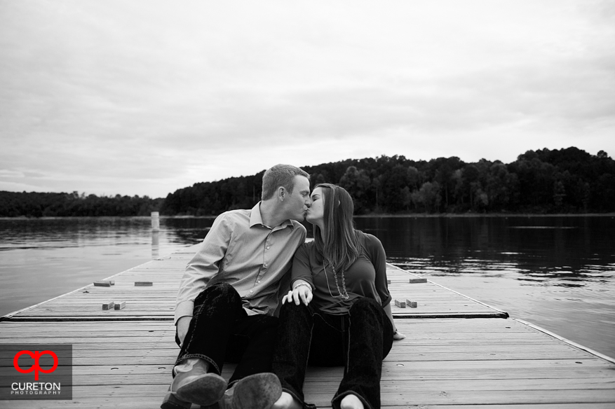 A couple sitting on the dock at Lake Hartwell.