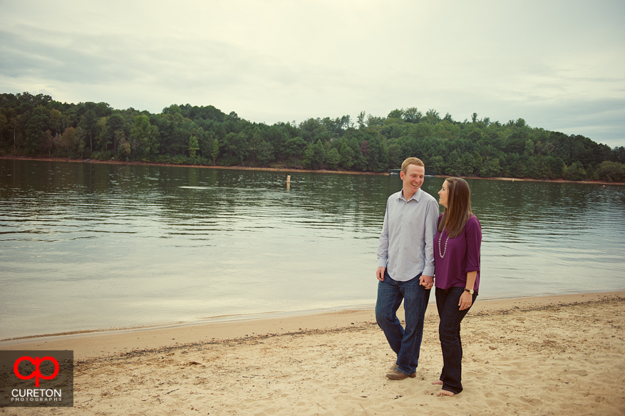 Couple walking on the beach at the Clemson rowing complex in Clemson,SC
