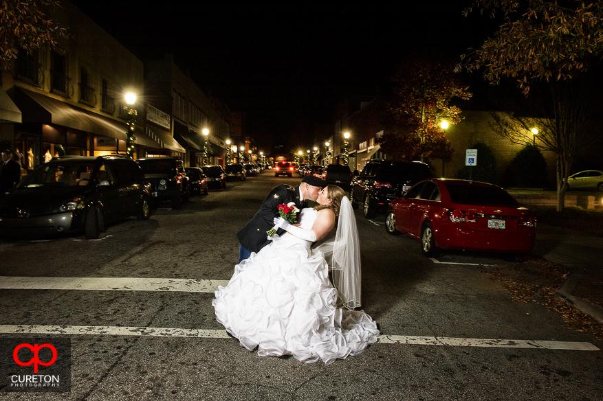 Groom dips bride on Trade Street in Downtown Greer,SC.