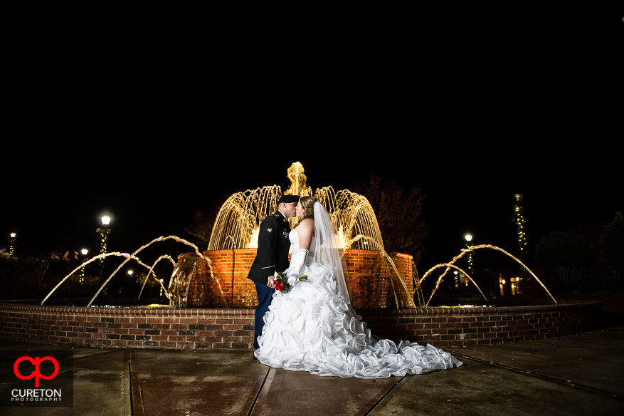 Bride and Groom in front of fountain.