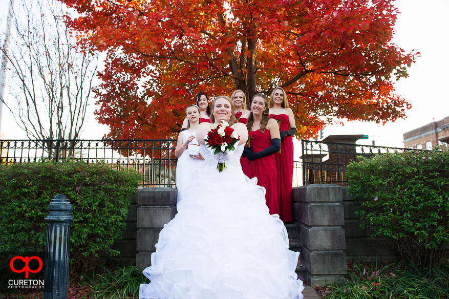 Bride pointing flowers at the camera.