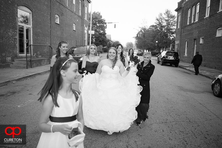 Bride and Bridesmaids walking the streets of downtown Greer,SC.