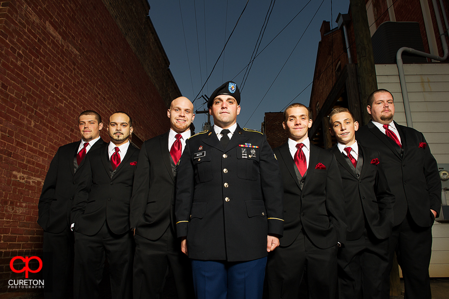 Groom in uniform with groomsmen outside at The Davenport in Greer,SC.