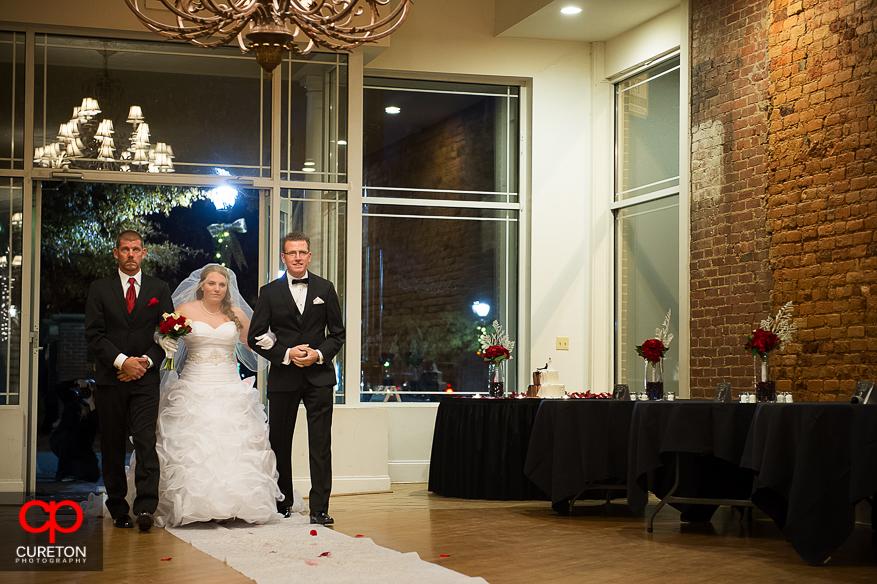 Bride and escorts enter her wedding.