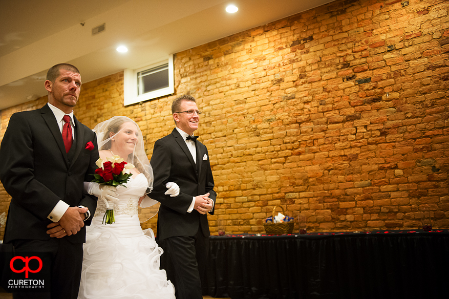 Bride escorted down the aisle at The Davenport.