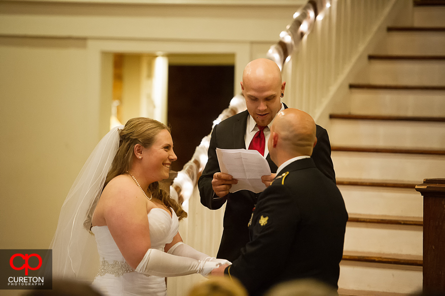Bride smiling during her wedding ceremony.