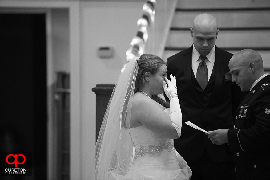 Bride crying at her wedding.