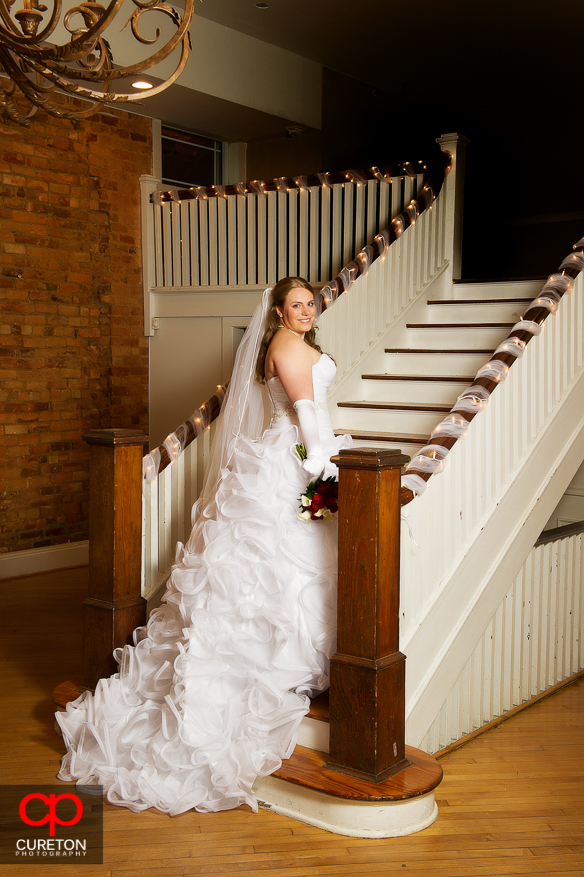 Bride on the stair case after her wedding at The Davenport in Greer,SC.