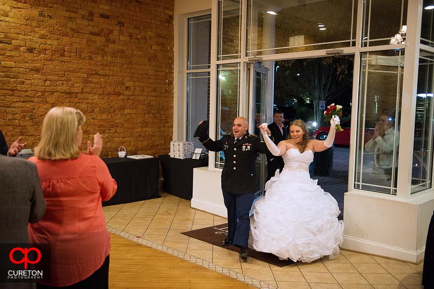 Couple entering their wedding reception.