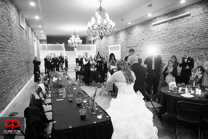 Couple enters the reception after their wedding at The Davenport in Greer,SC..