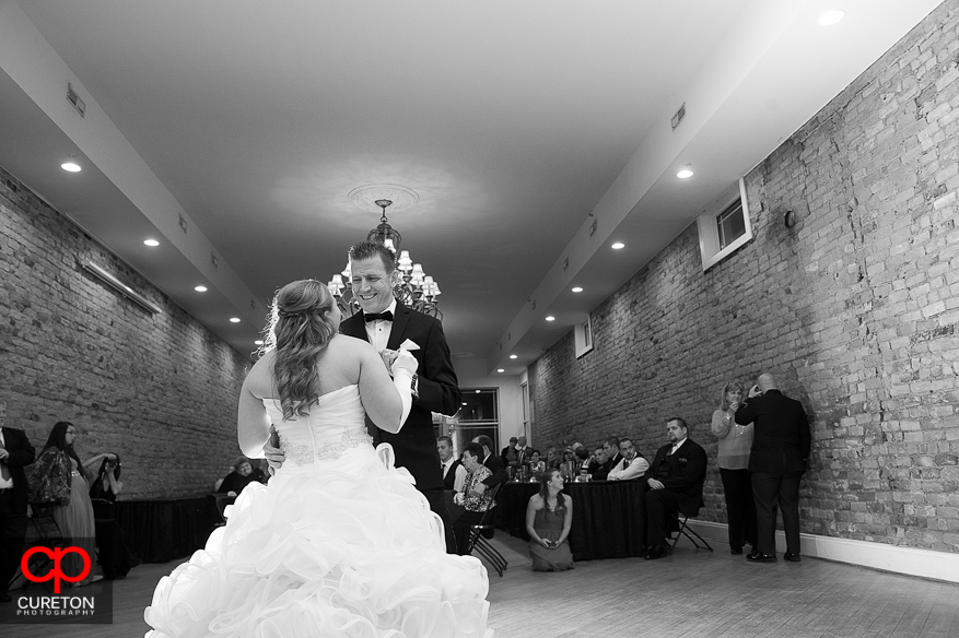 Bride and her father dancing at her reception.