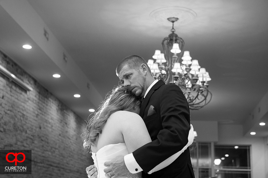 Bride and her uncle dancing at her wedding.