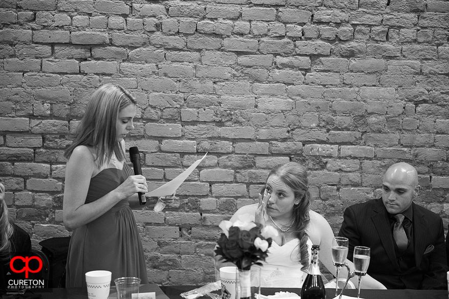 Maid of honor toasts bride.