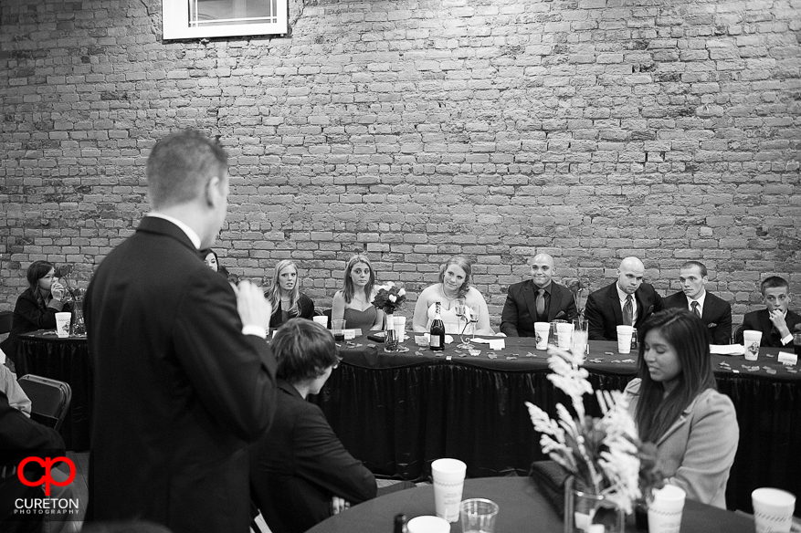 Father toasts the bride at the reception.