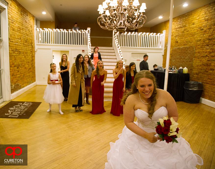 Bride throwing bouquet.