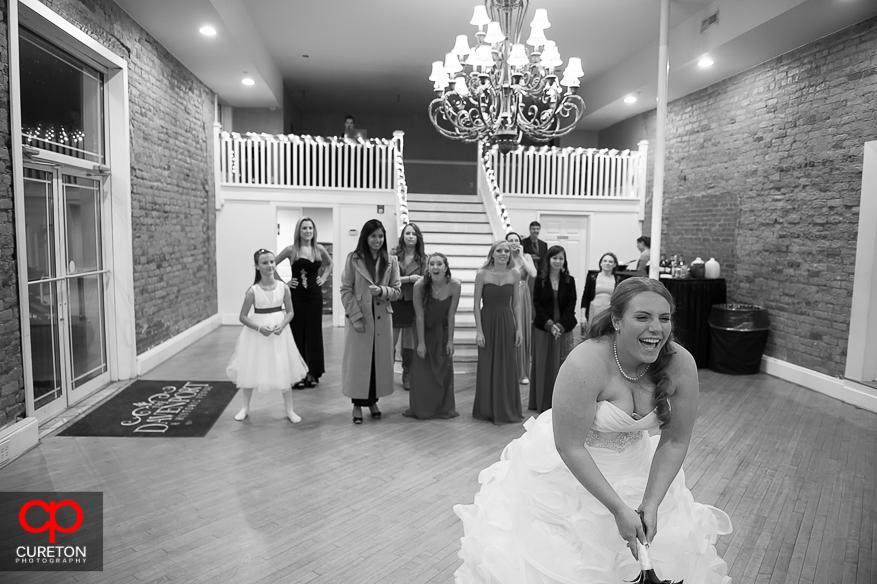 Bride prepares to throw her bouquet.