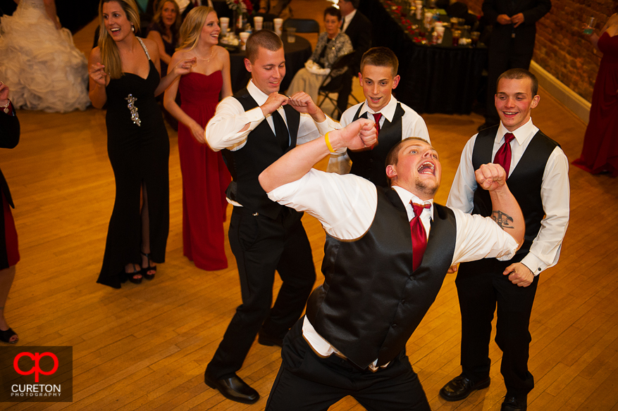 Awesome dancing shot of groomsmen at the reception.