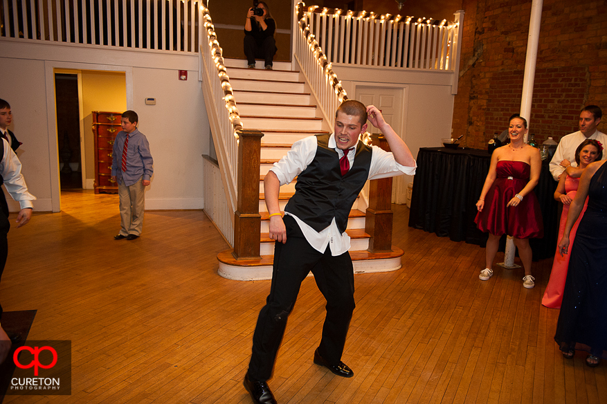 Groomsmen doing a dance to Ice Ice Baby at the reception.