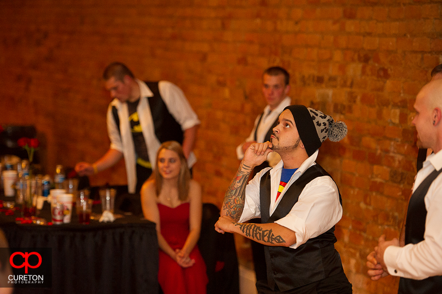Groomsman dancing at the reception.