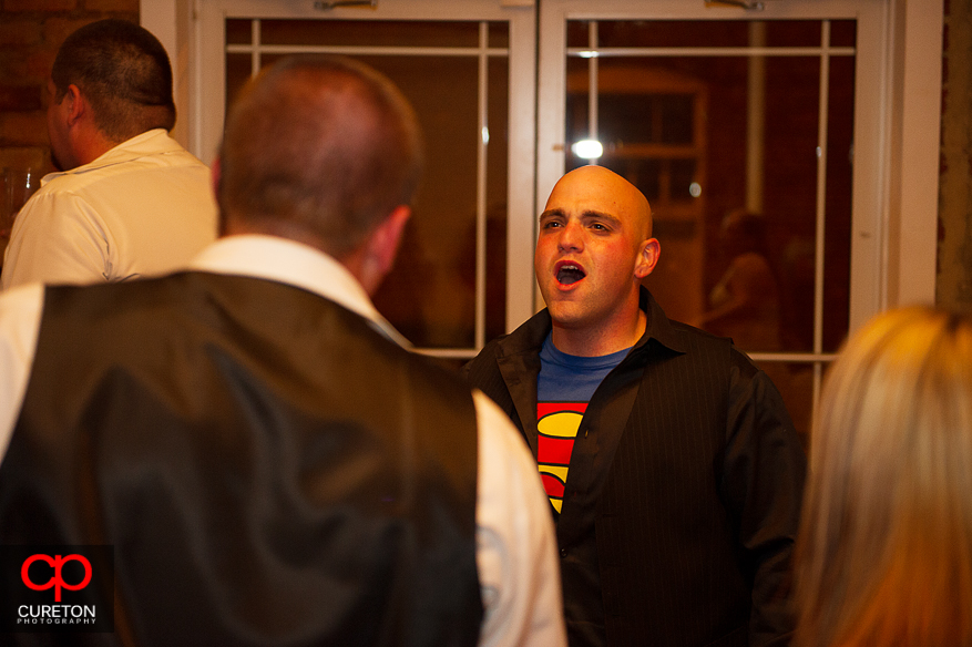 Groom singing to the music at his reception.
