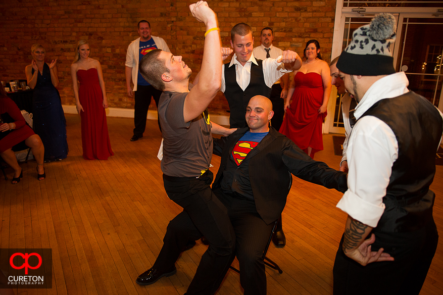 Groom and groomsmen dancing.