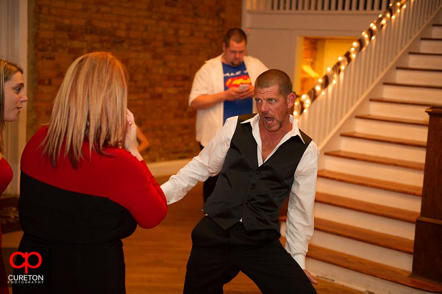 Bride's uncle dancing at her wedding.