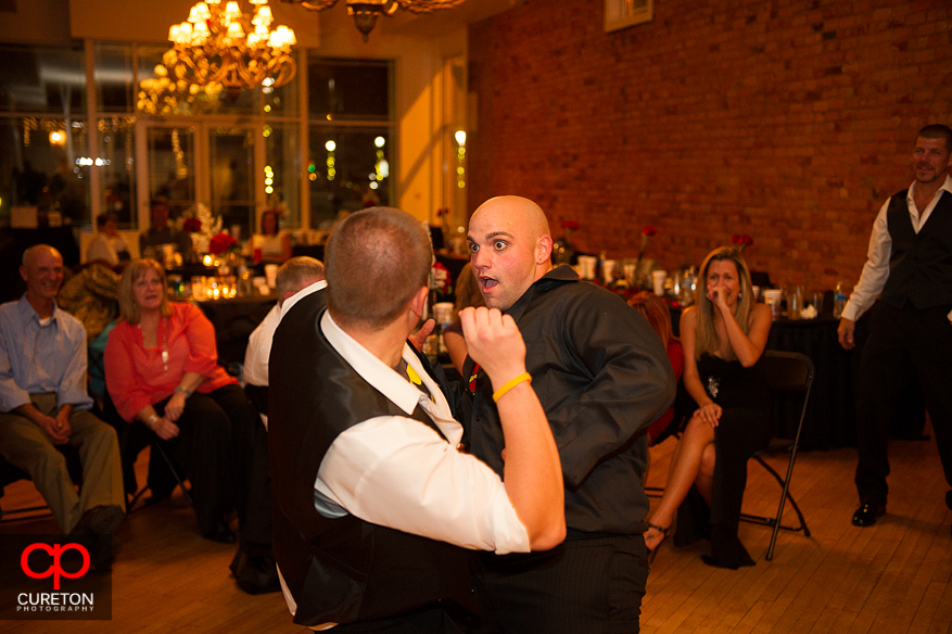 Groom and groomsmen dancing at a wedding at The Davenport in Greer,SC.