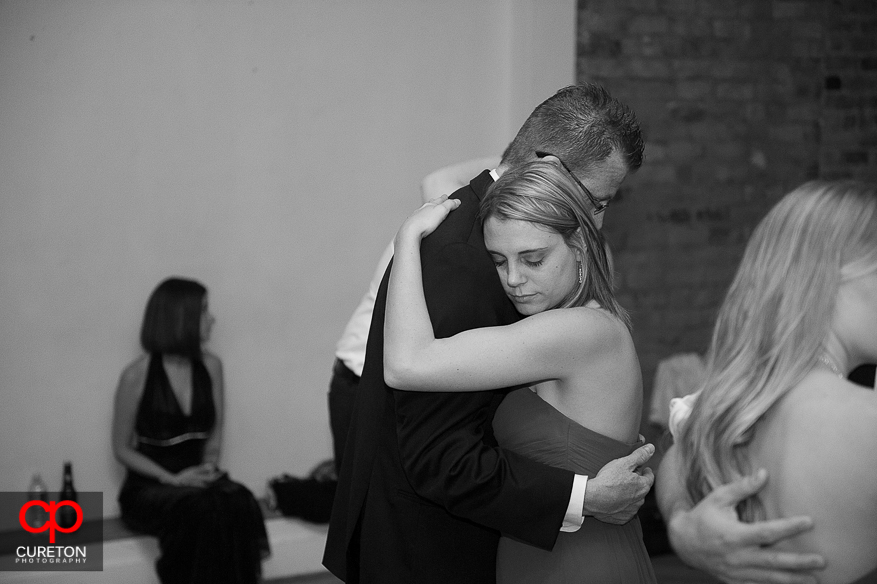 Bridesmaid dancing with her father at the reception.