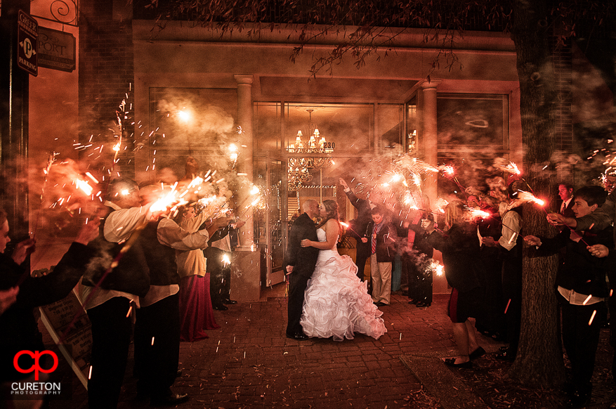 Couple standing in sparklers outside their wedding at The Davenport in Greer,SC.
