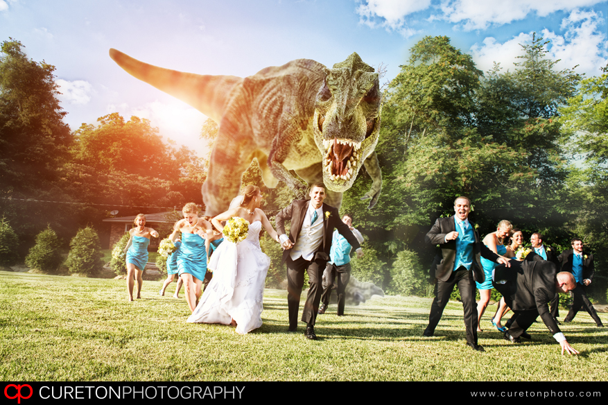 Dinosaur chasing wedding party outside the sawmill.