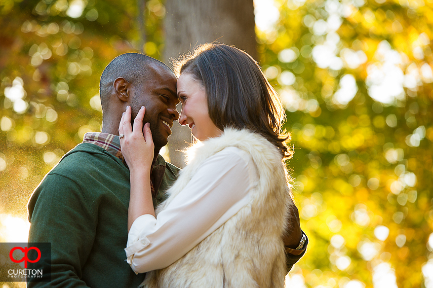 Couple looking at each other at Falls Park during their downtown Greenville SC engagement session..